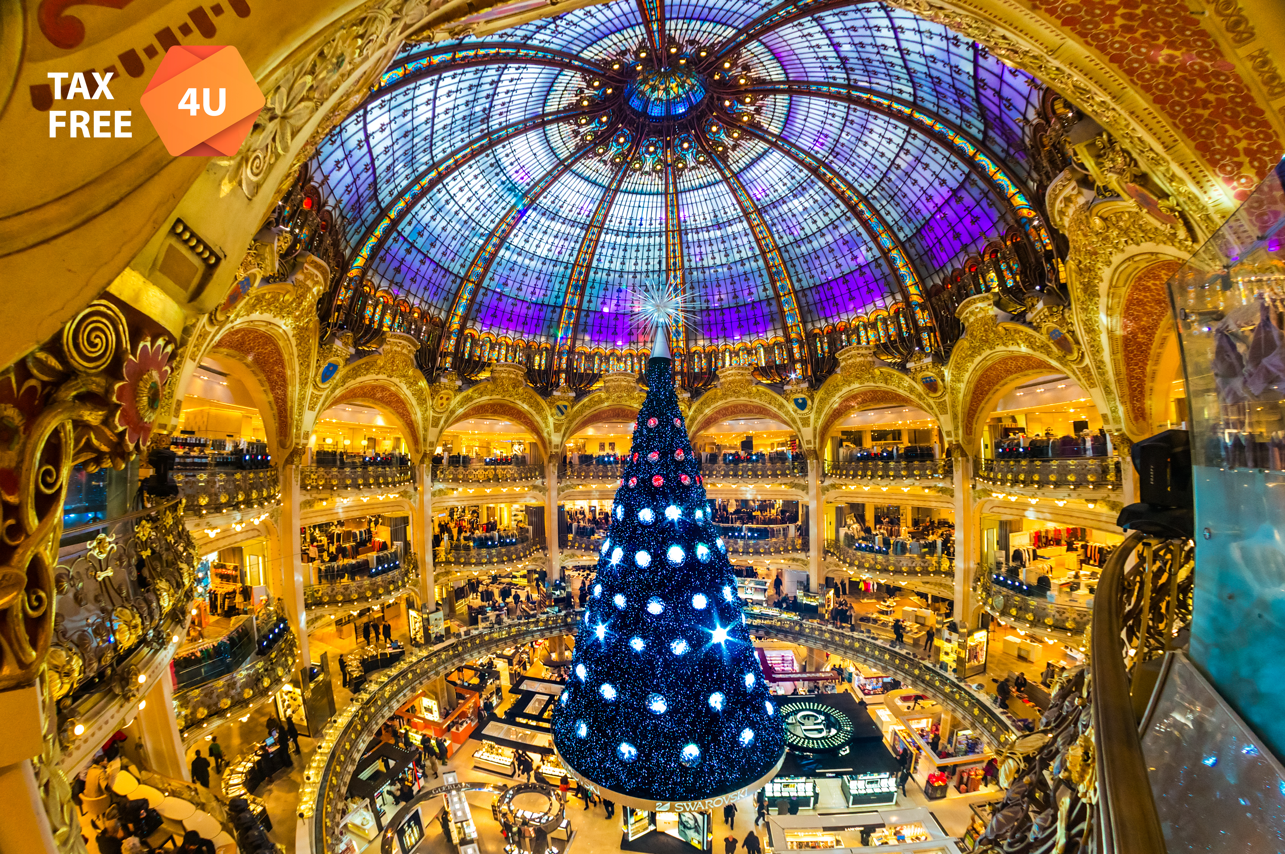 PARIS - DECEMBER 07: The Christmas tree at Galeries Lafayette on December 07, 2012, Paris, France.  The Galeries Lafayette has been selling luxury goods since 1895.