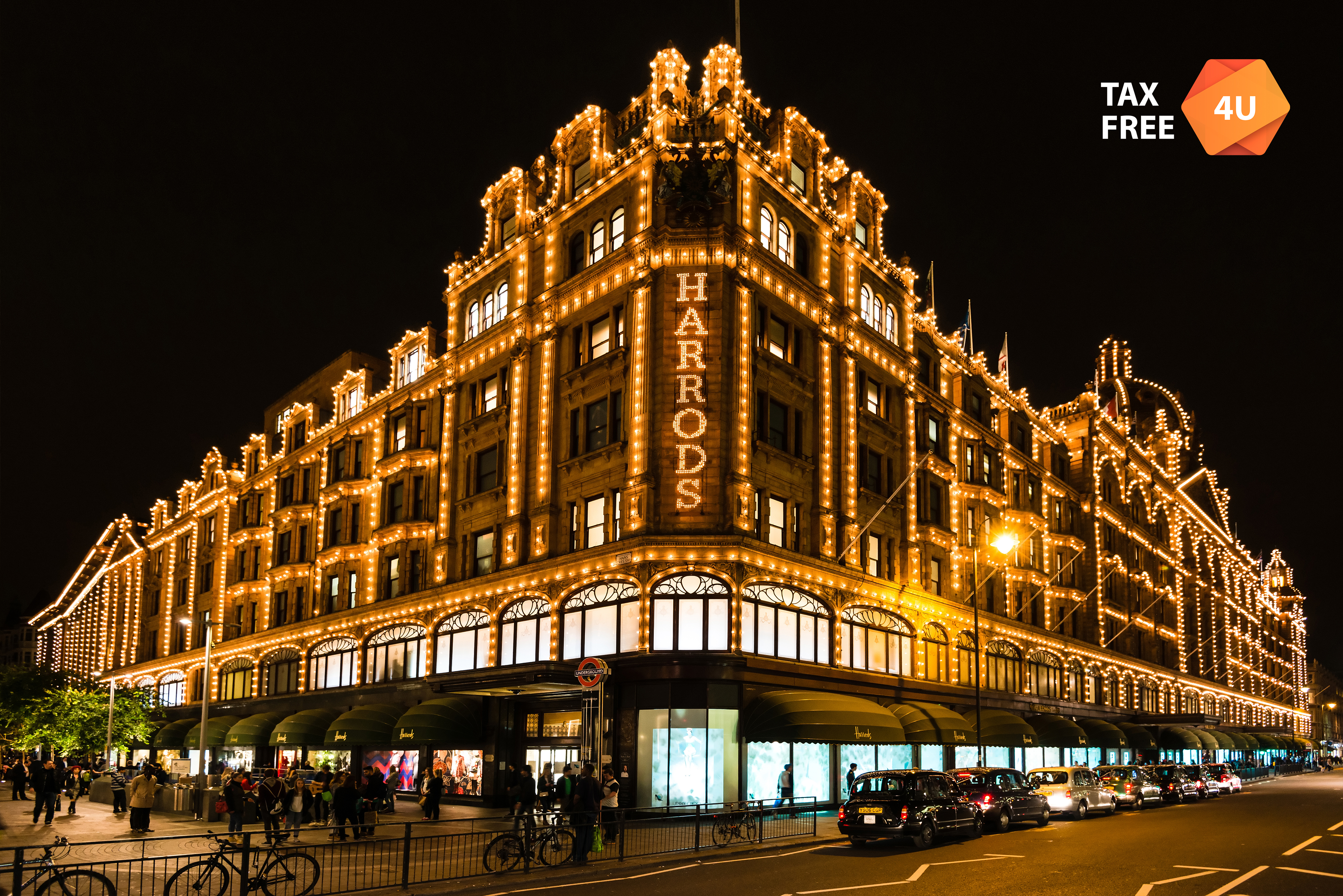 LONDON, UK - SEPTEMBER 25, 2014: The famous Harrods department store in the evening of September 25, 2014 at Knightsbridge in London, UK. Harrods is the biggest department store in Europe and offers over one million square feet of retail space, acting as a magnet for rich clients and numerous tourists throughout the year.